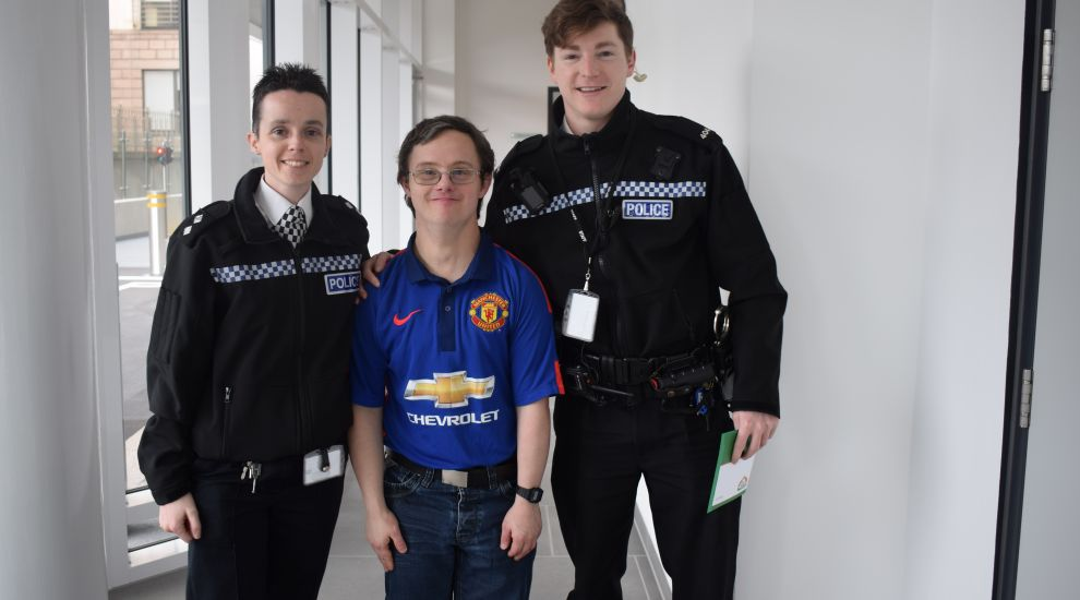 Police officers donate football tickets to Les Amis resident