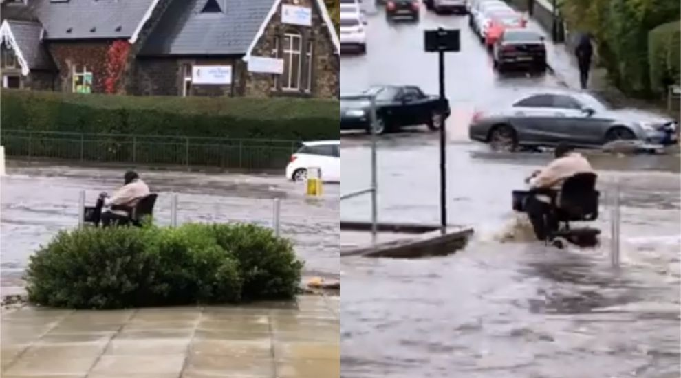 Mobility scooter driven through floods leaves onlookers astonished