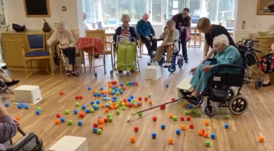 Care home recreates life-sized Hungry Hippos game to lift morale in isolation
