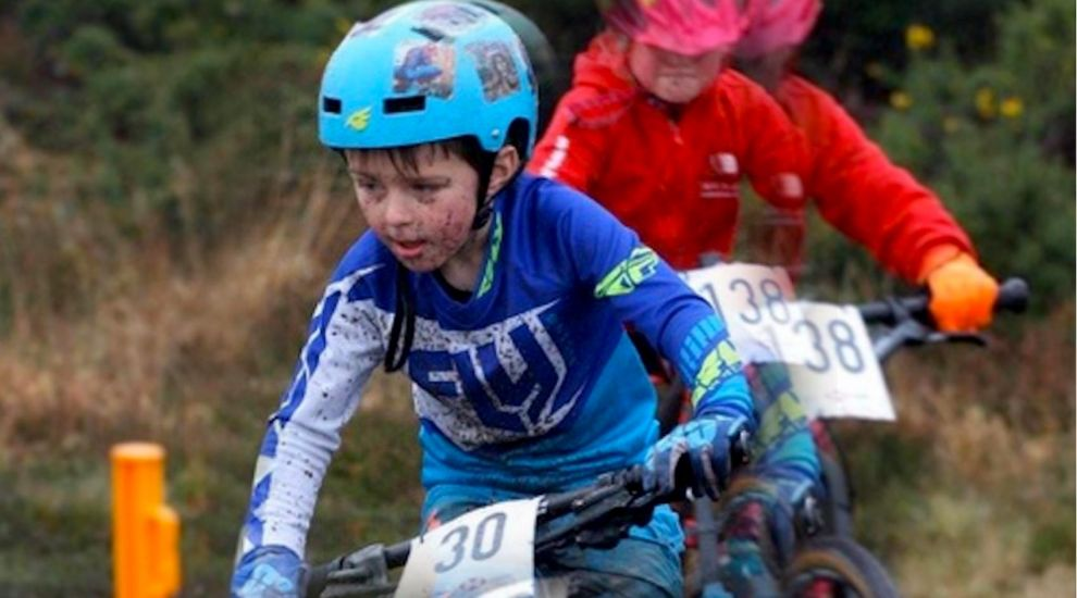 Young riders battle wind and mud in puddle-filled race