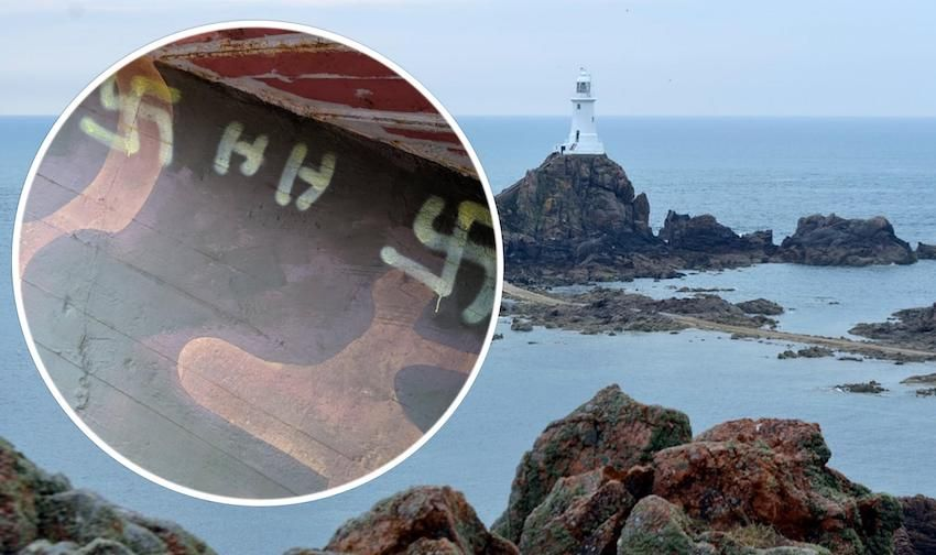 Castle and lighthouse daubed with swastikas