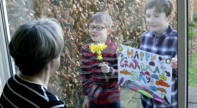Brothers describe 'happy and weird' Mother's Day through grandparents' window