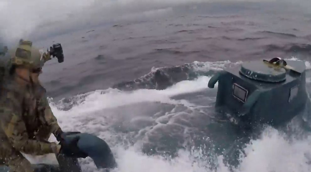 Watch: Dramatic video shows Coast Guard crew leap on to submarine in drugs bust