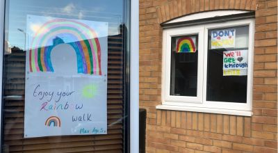 Children put rainbows in windows to raise spirits of passers-by