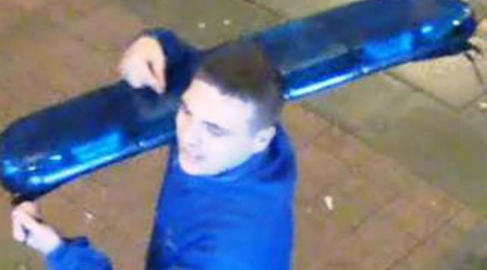 CCTV released after thief steals police lights from car