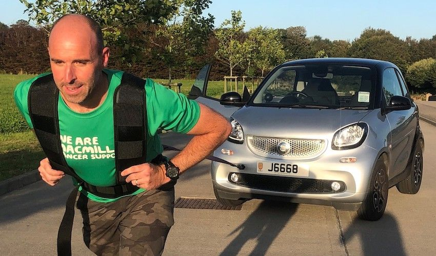 Ultra-runner to tow car for 26 miles