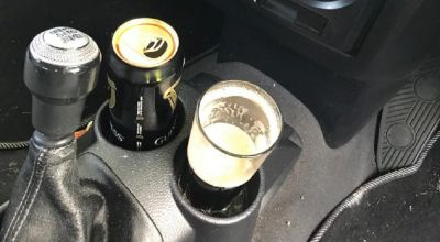 Man found with pint of Guinness in cup holder arrested