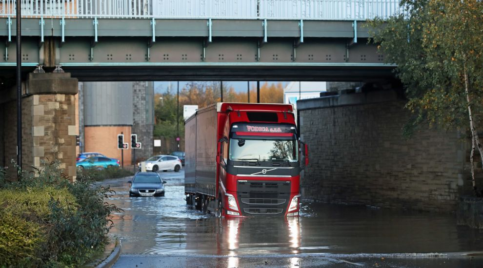 Flood warnings remain in place as Corbyn visits deluged community