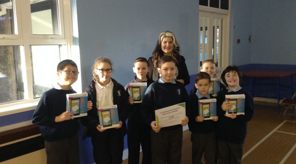 St Luke's Primary School receives 15 'tablets' as a reward for recycling