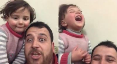 Syrian father teaches four-year-old daughter to laugh when bombs falls outside